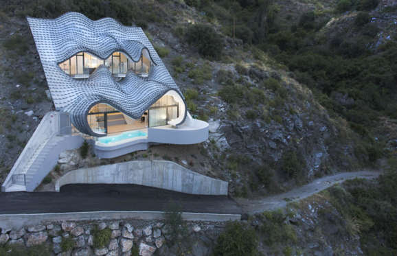 This psychedelic house by Gilbartolome Architects is ever so subtly built into a cliff-side in Salobreña in Spain.
