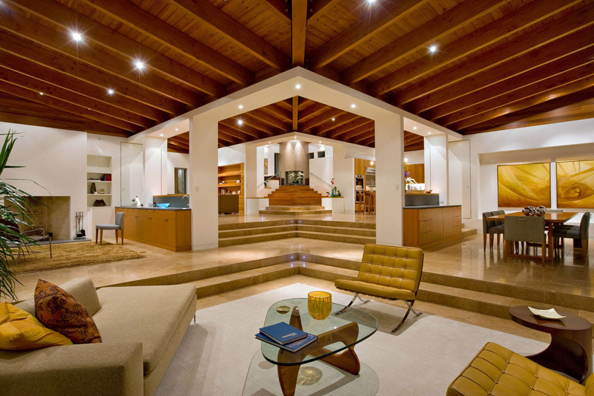 architecture interior design with amazing wooden ceiling for living room with beige sofa and classic ottoman plus glass top coffee table combined with dining room and kitchen