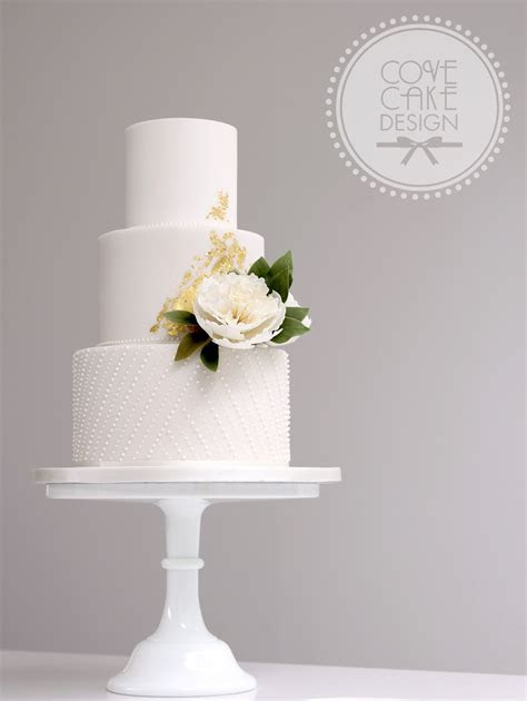 White fondant wedding cake with frilly sugar peony royal