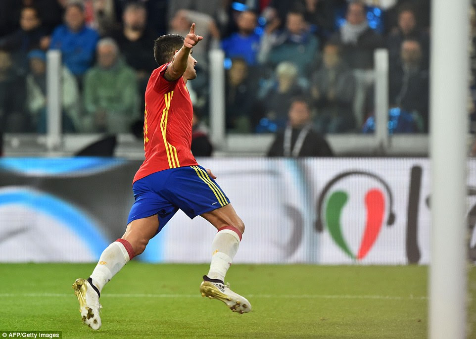 Vitolo wheels away in celebration after slotting home into an open net to hand Spain the lead