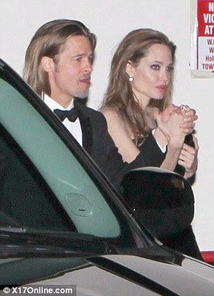Parte do tempo: Brad e Ange foram flagrados deixando a festa pós-George Clooney no restaurante Craig
