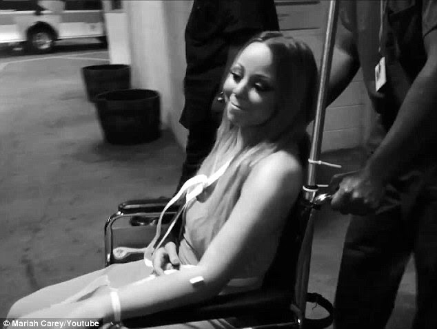 Brave face: The superstar smiled as she was wheeled to her car, sarcastically saying that the incident was 'fun'