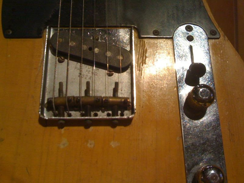 Close-up of Roy's '53 Telecaster bridge plate serial number 2324