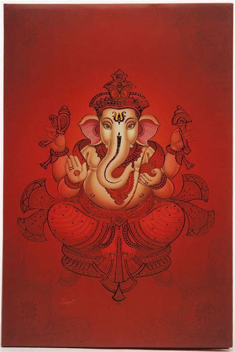 hindu wedding card with ganesha design in shades of orange