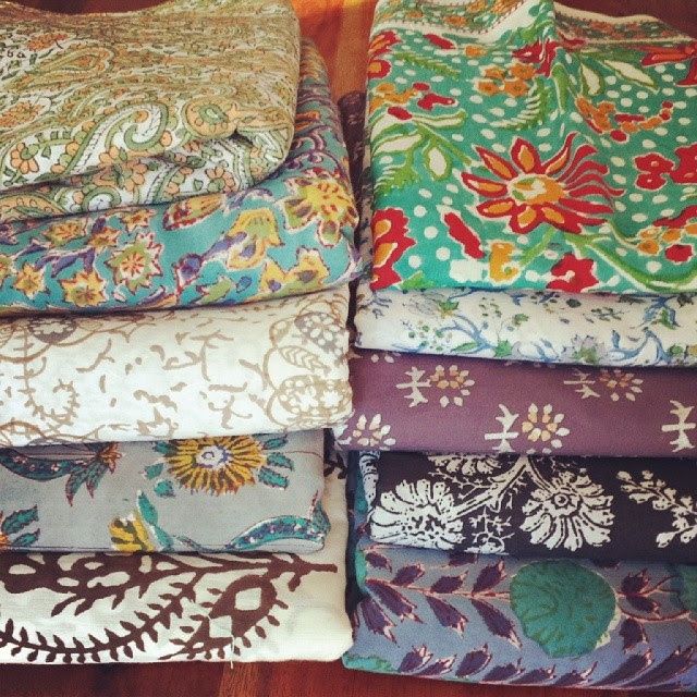 Stack of block printed cotton fabrics from India for me. Woot!