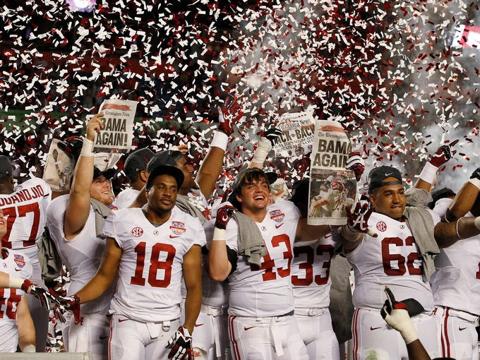 Alabama players celebrate after the BCS National Championship college football game against Notre Dame Monday, Jan. 7, 2013, in Miami. Alabama won 42-14. (AP Photo/Wilfredo Lee)  ORG XMIT: BCS210