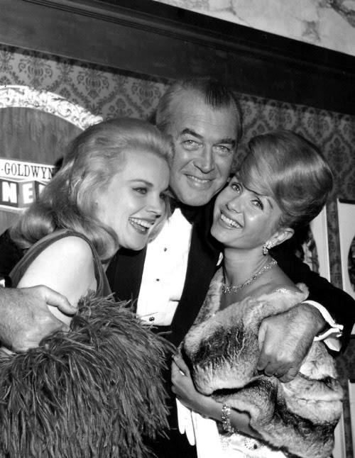 "Jimmy Stewart with Carroll Baker and Debbie Reynolds at the premiere of ""How the West Was Won"". February 20, 1963."
