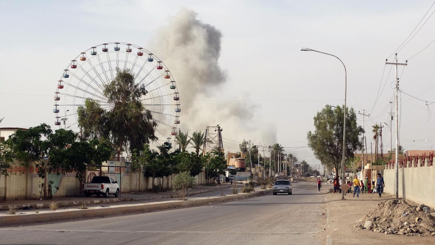 FILE - In this Saturday, May 9, 2015 file photo, smoke rises after an airstrike by the U.S.-led coalition on Islamic State group positions in an eastern neighborhood of Ramadi, the capital of Anbar province, 70 miles (115 kilometers) west of Baghdad, Iraq. (AP Photo/File)