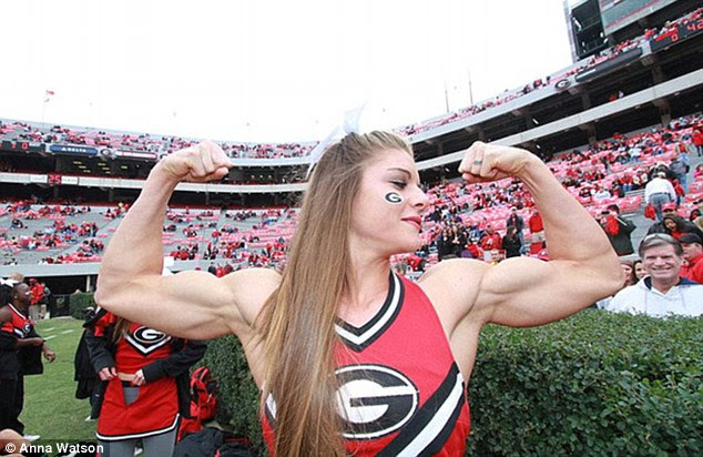 Gun show: University of Georgia cheerleader Anna Watson proudly displays her surmountable strength