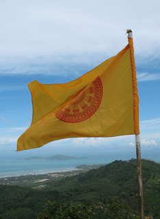 Flag and view of Koh Lon