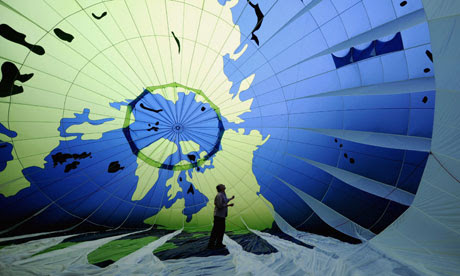 A Greenpeace activist in a hot air ballon ahead of the UN climate summit in Cancún