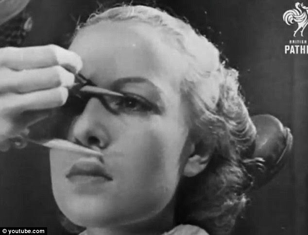 Sizing her up: A 1936 video made by British Pathe teaches women how to apply make-up and accentuate their features by measuring the uniformity of the face