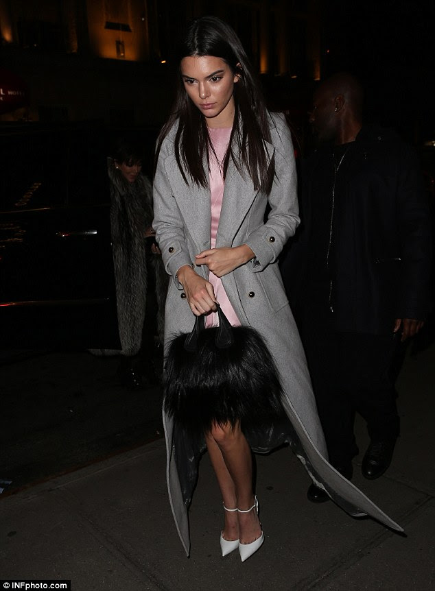 She takes the fur: Kendall Jenner joined the clan at the restaurant while clutching a black furry bag