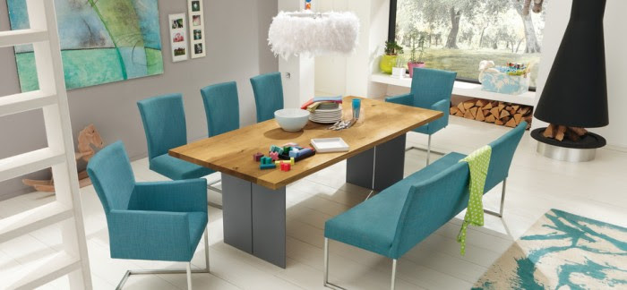 The use of natural woods and light airy colors of turquoise, blue and green on modern furnishings and accessories create a modern coastal style that lends itself to a beach house or seaside townhome.