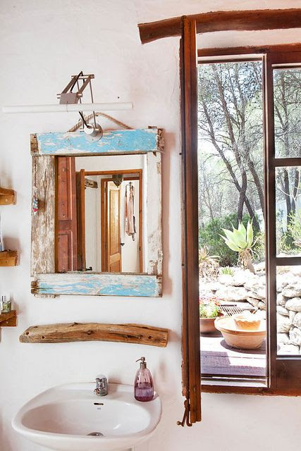 Holiday villa for rent on Ibiza by the style files, via Flickr Spiegel aus altem Holz mit moderner Lampe kpmbiniert