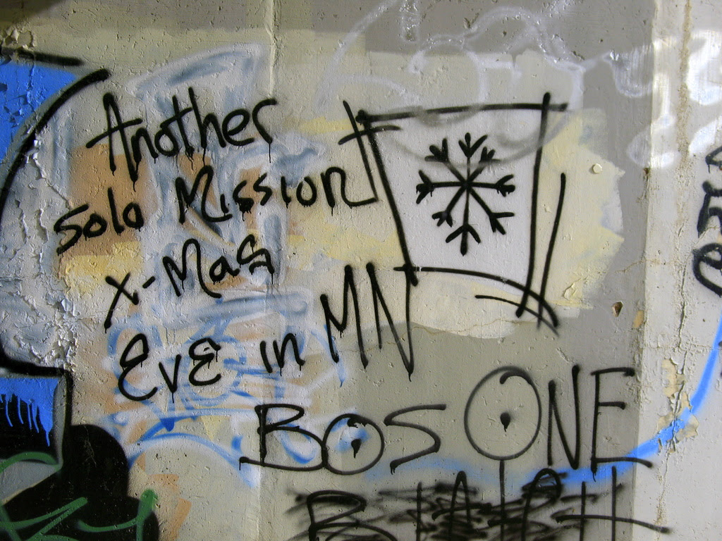 some graffiti found under the higway 61 overpass in the tunnel