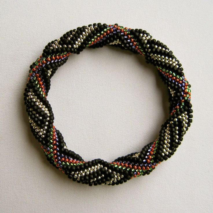 Dreamer Bead Crochet Bangle:  A highly dimensional 12-around bead crochet bangle.    Pattern available at:  https://www.etsy.com/shop/WearableArtEmporium (In the Bead Crochet 12-Around Section)