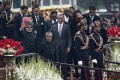 U.S. President Barack Obama (C) , flanked by first lady Michelle Obama, India's Prime Minister Narendra Modi (in turban) and his counterpart Pranab Mukherjee, leaves after attending the Republic Day parade in New Delhi January 26, 2015. REUTERS/Ahmad Masood