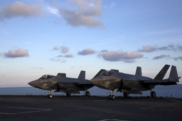 Two F-35C Lightning II aircraft sit on the flight deck of the USS Abraham Lincoln...on August 20, 2018.