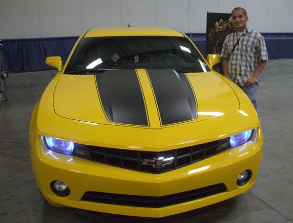 Posing in front of the Camaro used for Bumblebee in TRANSFORMERS.