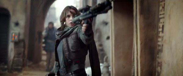 Jyn Erso opens fire on Imperial Stormtroopers (off-screen) in ROGUE ONE: A STAR WARS STORY.