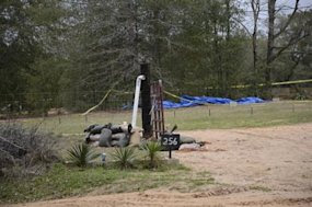 Search for bombs resumes at Alabama hostage site after two found