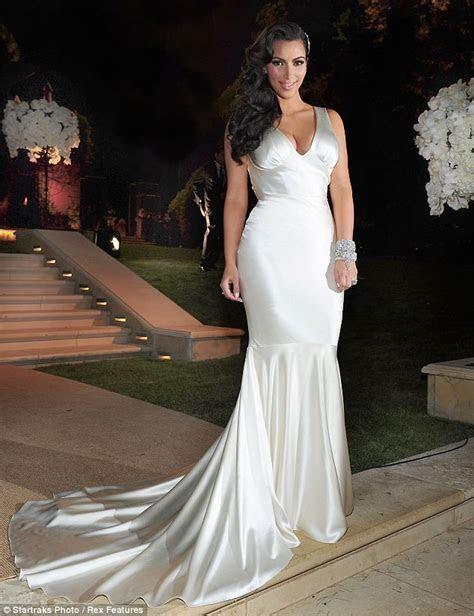 Costume change: Newlywed Kim Kardashian dons dress number