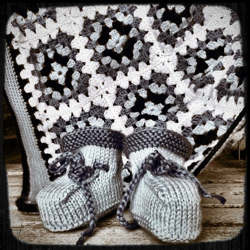Black and white knitted booties
