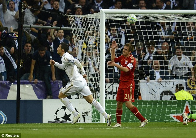 Sharpshooter: Ronaldo (left) wheels away after scoring Real Madrid's second goal of the night