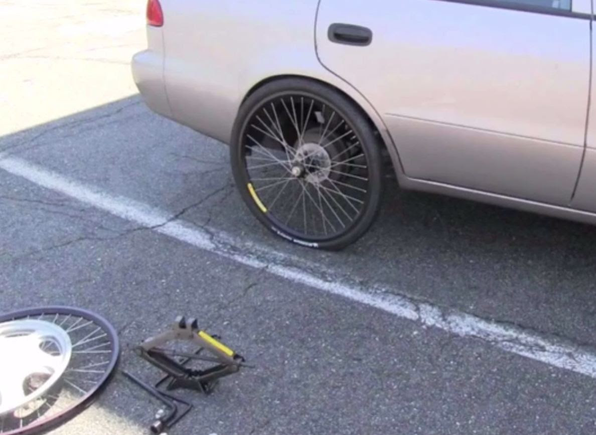 Flat Tire On Your Car Just Mount Up A Spare Bicycle Wheel