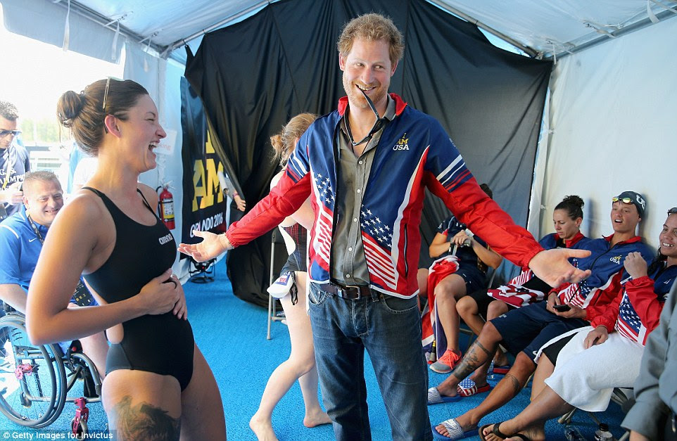 Without a man's jacket to hand the Paralympic swimmer Elizabeth Marks attempted to squeeze the royal into her own petite uniform