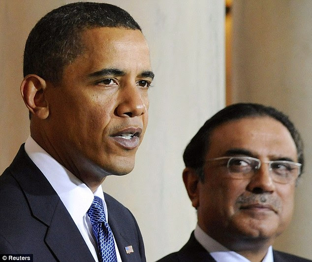Pakistan's President Asif Ali Zardari looks on as U.S. President Barack Obama makes a statement to reporters at the White House in Washington