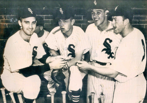 thestrawthatstirsthedrink:<br /><br />Big Day in Chicago! Billy PIerce, Nellie Fox, Chico Carrasquel, and Vern Stephens celebrate the birth of Pierce's son after beating the Tigers 14-4 on July 8, 1953UPI<br />