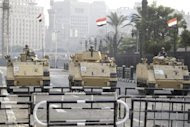 Soldiers sit atop army vehicles as they stand by Tahrir square in Cairo October 11, 2013. REUTERS/Mohamed Abd El Ghany