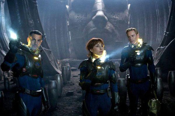 Charlie Holloway (Logan Marshall-Green), Elizabeth Shaw and David (Michael Fassbender) explore inside a dark chamber in PROMETHEUS.