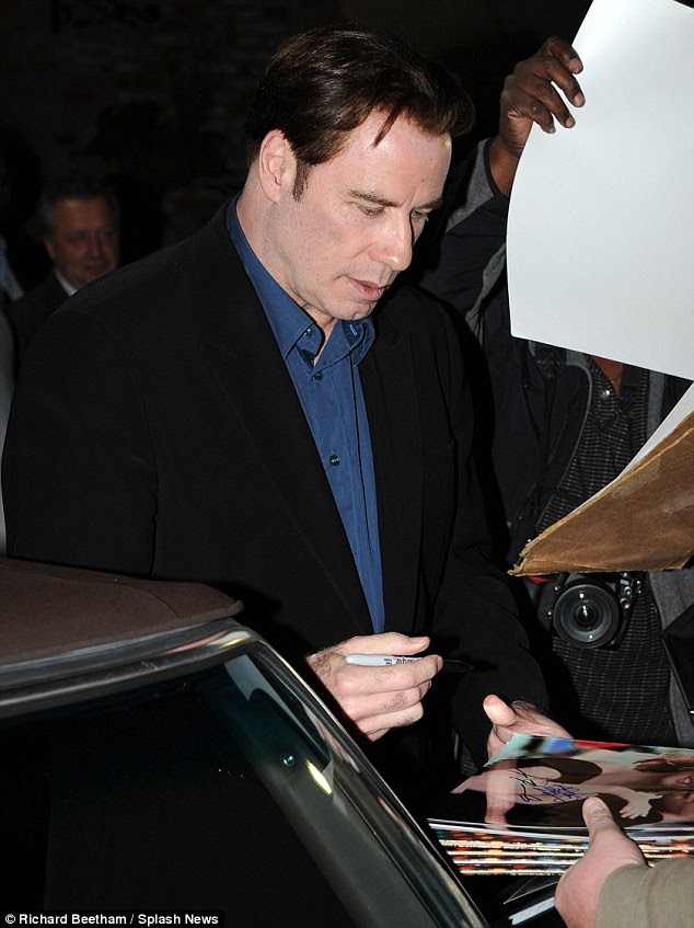 Which John would you like? Travolta signs autographs for fans outside the restaurant after his role as Gotti is given the go-ahead