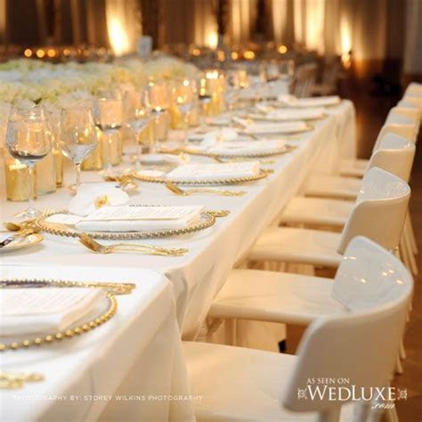 Gold and ivory table settings #goldwedding #