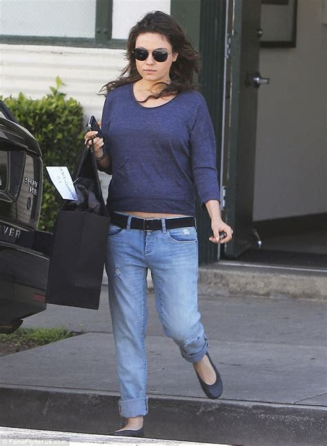 'Pregnant' Mila Kunis steps out in comfy blue top and