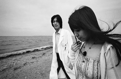 Zhu Dan and Toru Inamura in THE WHITE FLOWER