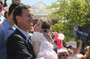 FILE - In this June 6, 2011 file photo, former Pennsylvania Sen. Rick Santorum holds his daughter Isabella before announcing he is entering the Republican presidential race, on the steps of the Somerset County Courthouse in Somerset, Pa. Santorum canceled his morning campaign events, Sunday, Jan. 29, 2012, and planned to spend time with his hospitalized daughter, Bella. Isabella Santorum has Trisomy 18, a genetic condition caused by the presence of all or part of an extra 18th chromosome. (AP Photo/Gene J. Puskar, File)