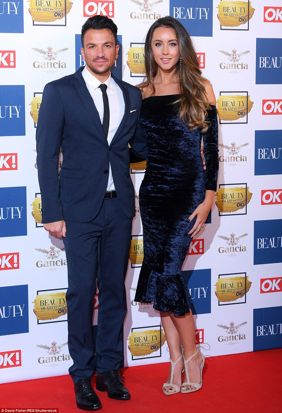 The happy couple:Peter Andre left his troubles behind as he hit the red carpet with his doctor wife Emily MacDonagh at Tuesday evening's glitzy OK! Magazine Beauty Awards 2017, where the couple looked unfazed by the headlines