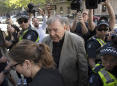 The Latest: Vatican investigates Pell after conviction