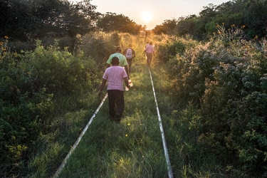 Central American migrants headed for the United States walked along train tracks near Los Corazones, Mexico.