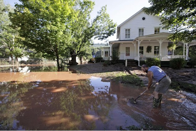 Michael Lancto digs a drain for water to flow away from his and others houses after Tropical Storm Irene flooded parts of the town, Tuesday, Aug. 30, 2011 in Windham, N.Y. Officials say more than a do