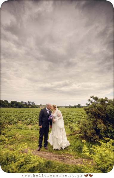 Kissing at wedding in field Cute - Suffolk Bromswell Eyke Vintage English wedding Photography - Hello Romance