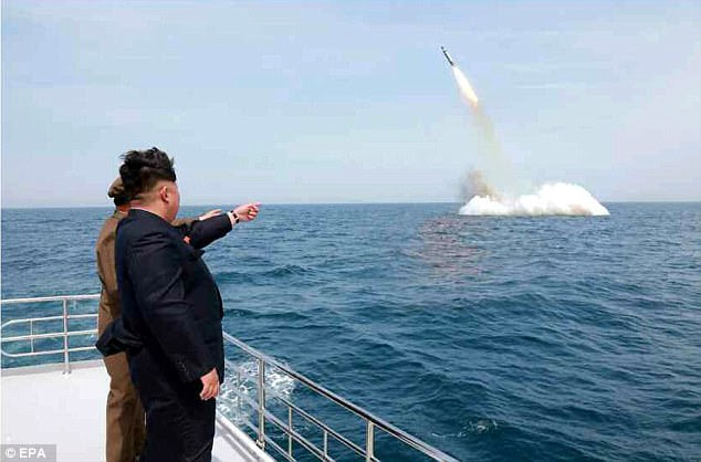 Pyongyang is now in the final stages of testing a nuclear weapon at Punggye-ri on the east coast 'at any time' once the dictator gives the green light, officials in the region have claimed. Kim Jong-Un is pictured viewing a ballistic missile launch