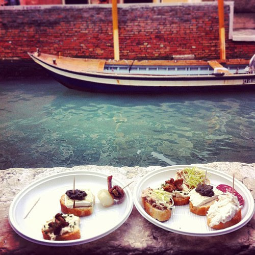 Enjoying the delicious cichetti of Venice by the canal. An indescribable experience.