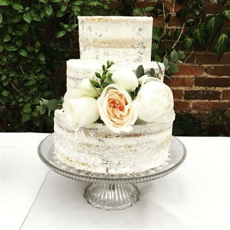 Semi naked cake with silver leaf by www.andifreemancakes