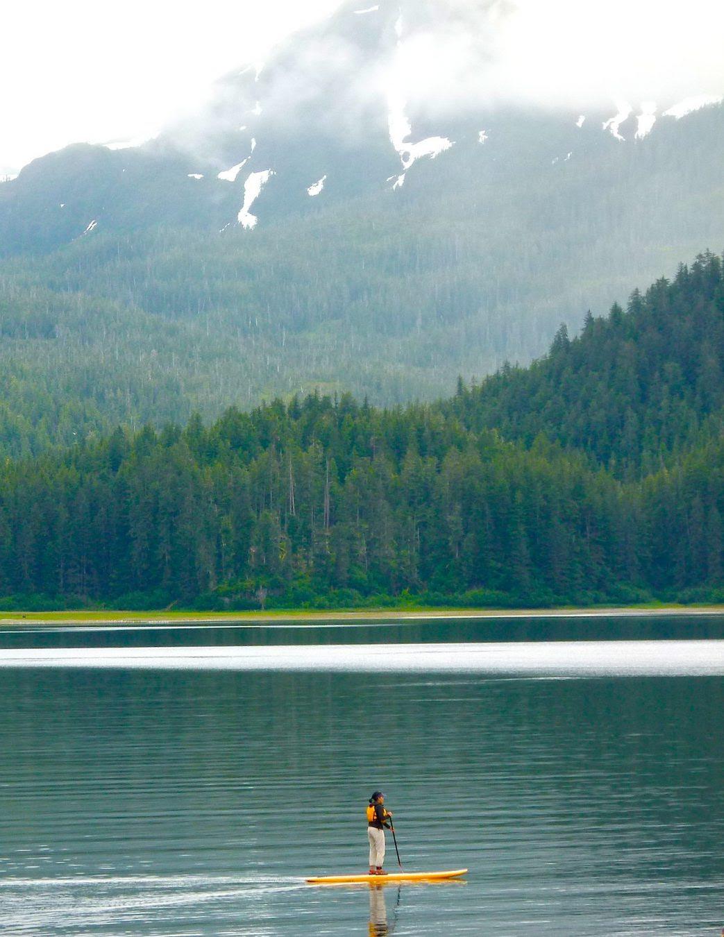 Janet Lien paddle boards in the beautiful Alaskan wilderness.