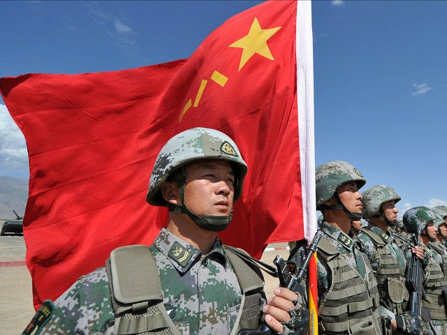 A Chinese soldier holds a Chinese flag during Peace Mission-2016 joint military exercises of the Shanghai Cooperation Organization (SCO) in the Edelweiss training area in Balykchy some 200 km from Bishkek on September 19, 2016. The joint anti-terrorism drill involves more than 1,100 troops of Russia, Kazakhstan, Kyrgyzstan, Tajikistan, Uzbekistan and China as members of the Shanghai Cooperation Organization. / AFP / VYACHESLAV OSELEDKO (Photo credit should read VYACHESLAV OSELEDKO/AFP/Getty Images)